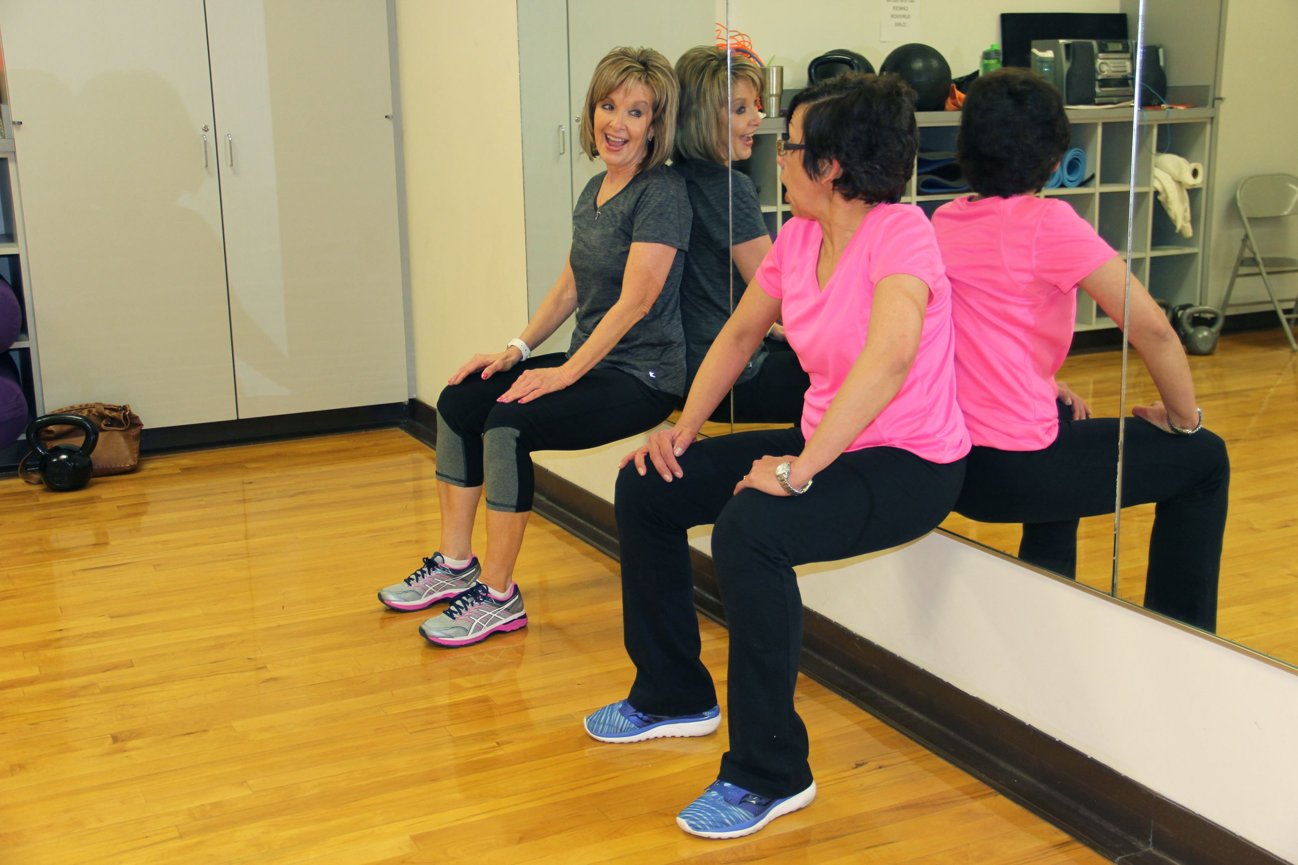 Women doing wall sits