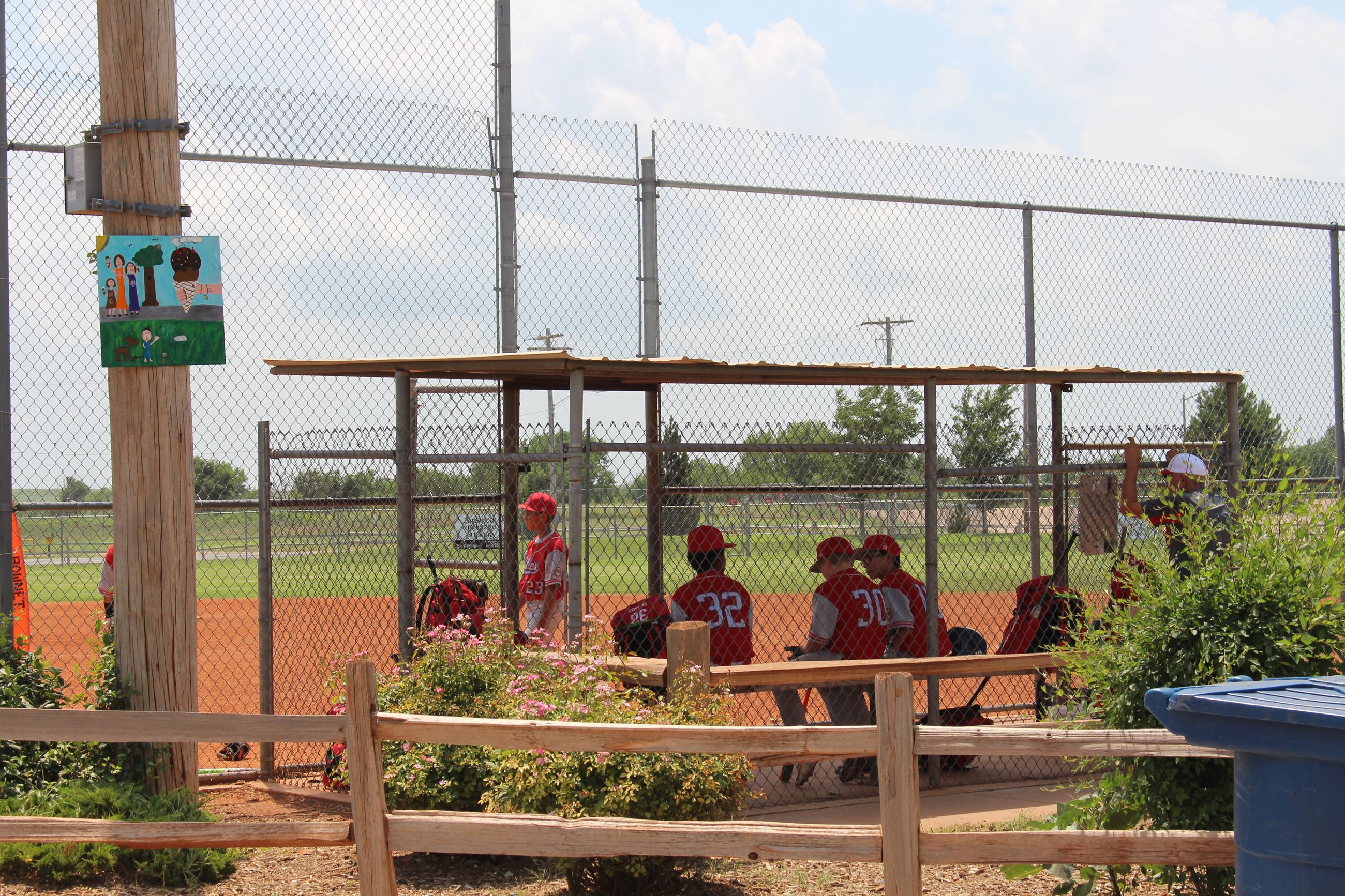 Baseball Players Standing in Dugout